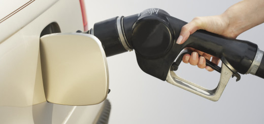 Woman Pumping Gas Into Car --- Image by © Royalty-Free/Corbis
